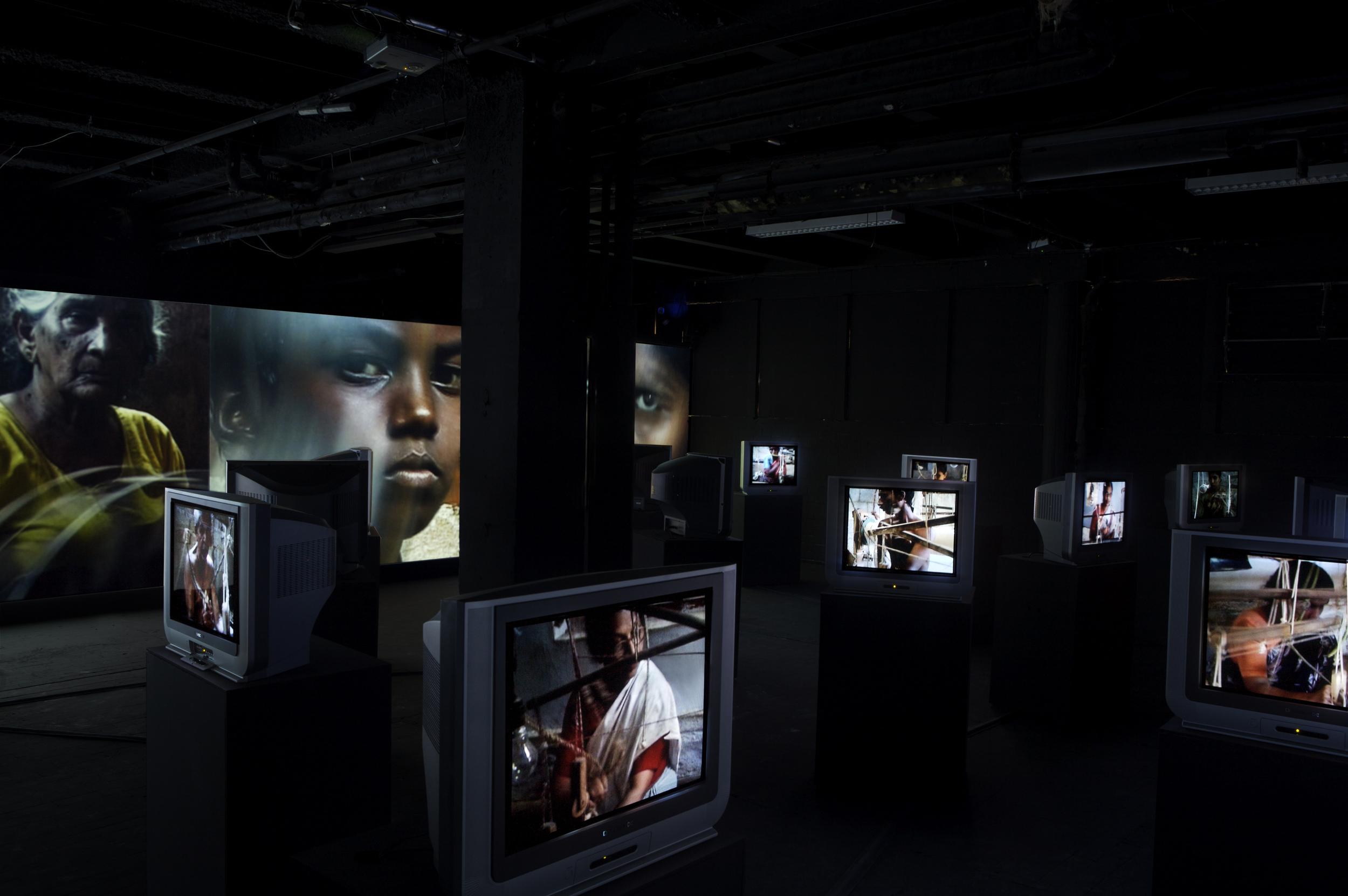 LA FABRIQUE (2006) VIDEOGRAMME,  25 TVS, 4 WALL PROJECTIONS, 29 SOUND SOUCES