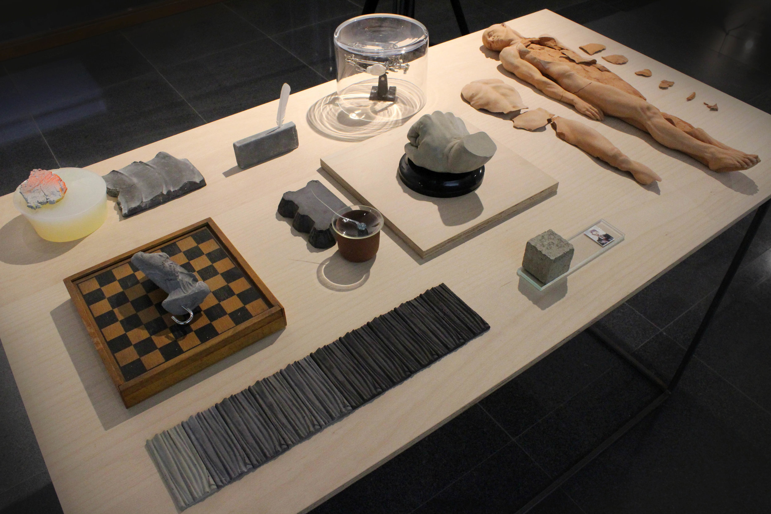 WORKING TABLE (2013) terracotta, glass, concrete, photography, wood, paint, resin, feather, variable dimensions
