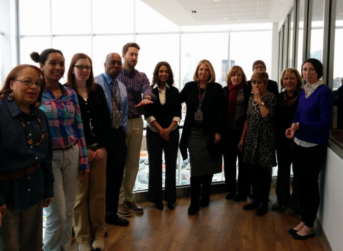 Staff from the Lauren J. Wylonis, MD, and Joseph R. Zebrowitz, MD, Center for Student Services, which comprises Admissions and Financial Aid, the Curriculum office, and the program for Diversity and Inclusion, gather outside of their offices during opening week of the Jordan Center.