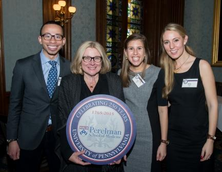 Penn Medicine Trustee and 250th Celebration Co-Chair Rosemary Mazanet, GR'81, M'86, PAR'11, flanked by current students, left to right, Wes Phillips, M'15, Yael Nobel, M'15, and Maren Shapiro, M'16, at the Penn Club for Penn Medicine's regional event in New York City.