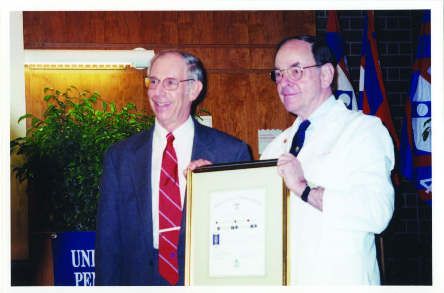 Dr. Albert receiving the Distinguished Alumni Award in 2001.