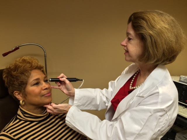Dr. O'Brien examining a patient.