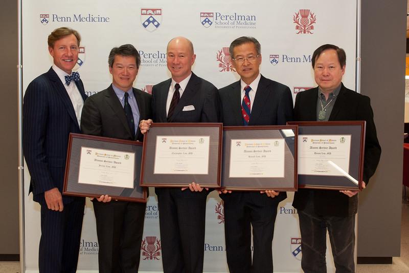 Alumni Service Award winners:   Jeremy Law, M'86,Christopher Law, C'78, M'82,Ronald Law, C'71, M'75, and  Dennis Law, C'69, M'73