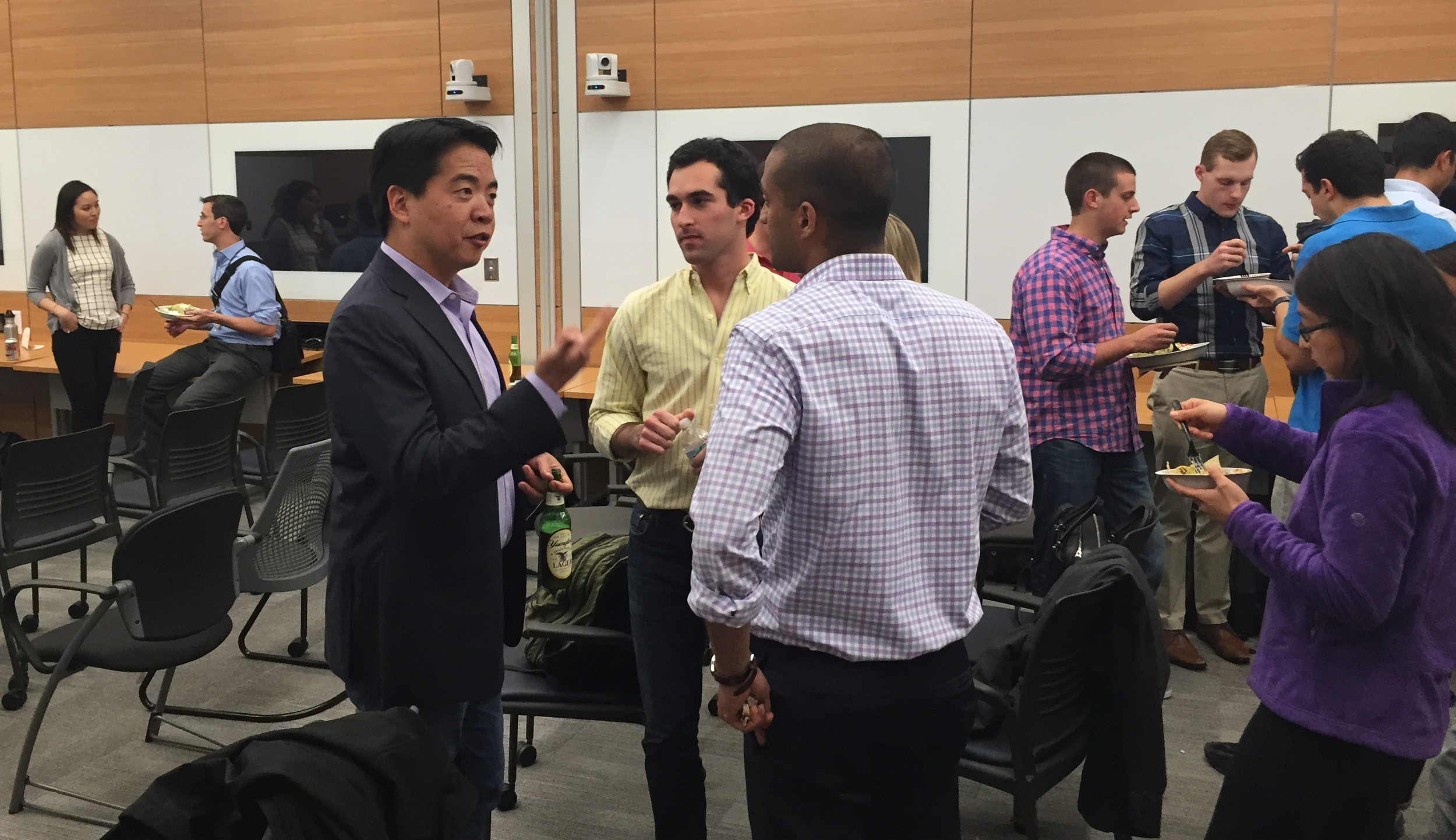 Lorence Kim, M'99, WG'99, speaks to Alex Rosen, M'16, WG'16, and Vinayak Nikam, M'17, WG'17.