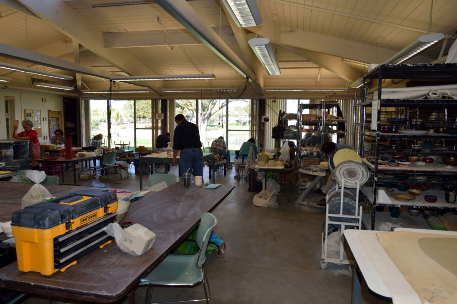Large slab roller and work tables for hand-building.