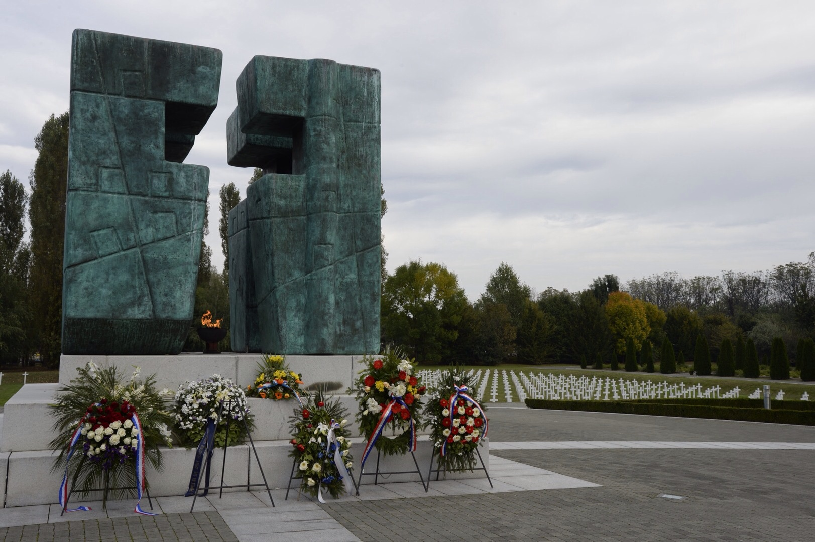 This statue of a cross in the War Victims Memorial holds an eternal flame to remember the Defenders and innocent civilians who dies during the war.