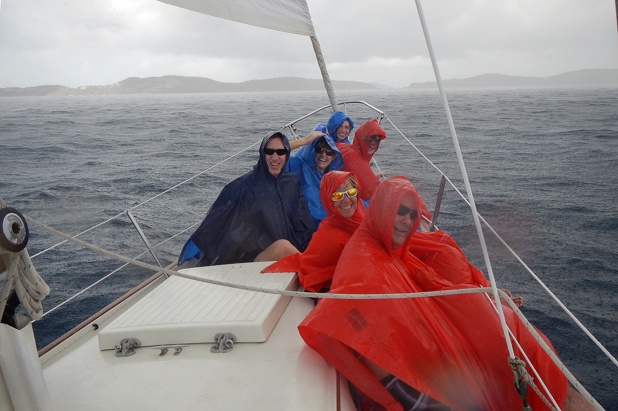 "Bonding on Calabaza in St Thomas during a squall with new friends we met ""online"" and shared a sailboat charter with. (I promise the sun was out for most of it!)"