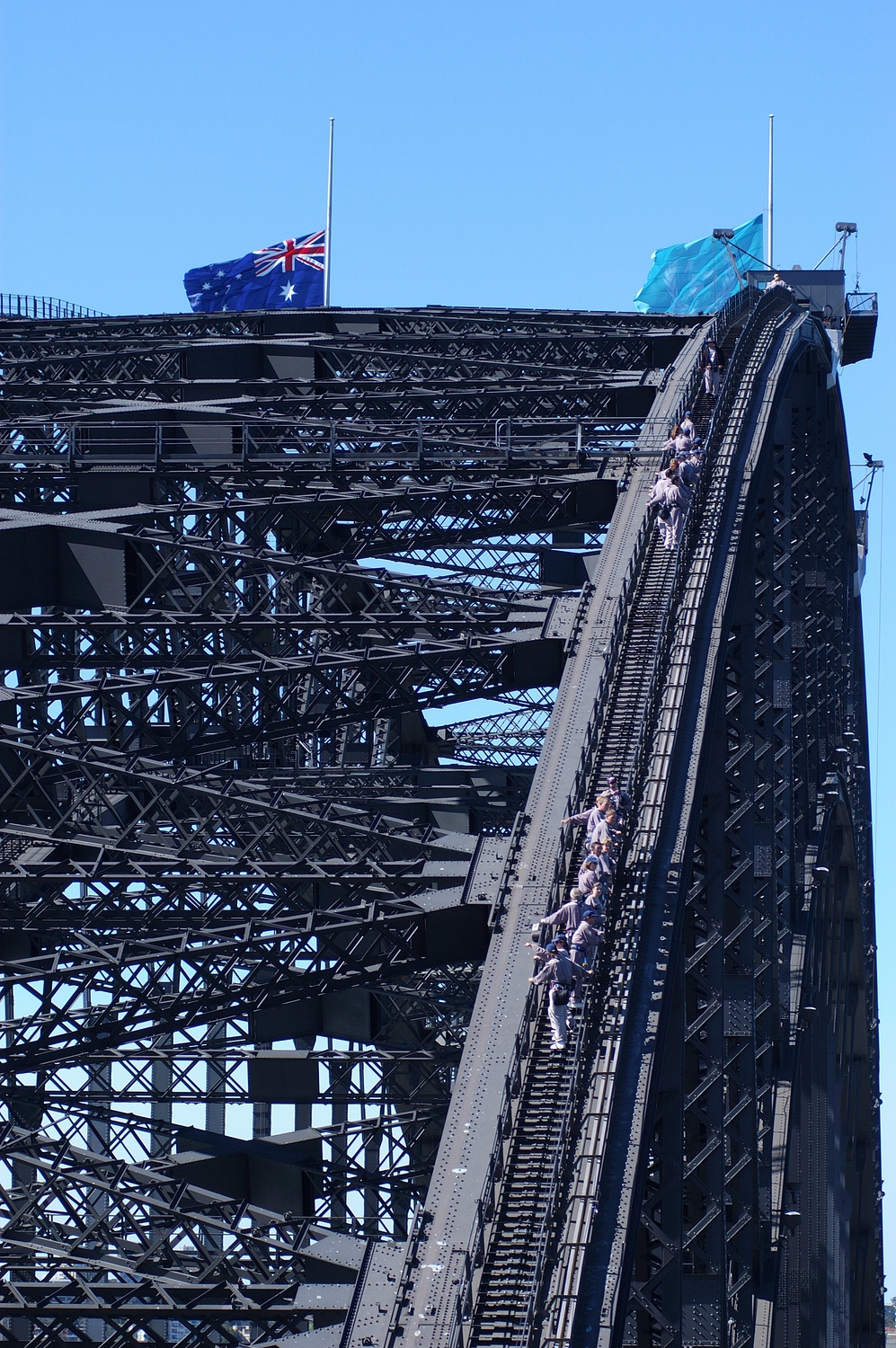 Bridge Climbers working their way up the bridge- notice the flags still flying at half mast after the Bali bombings.