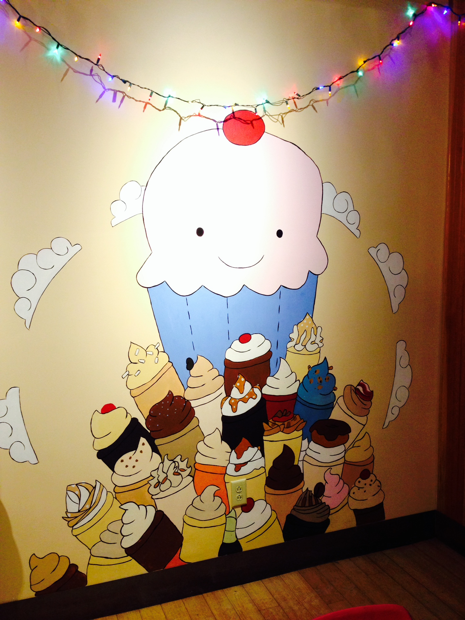A colorful mural, (another bad iPhone photo) with the happy (not so little) little cupcake that serves as the mascot for the two My Little Cupcake shops in Vermont.