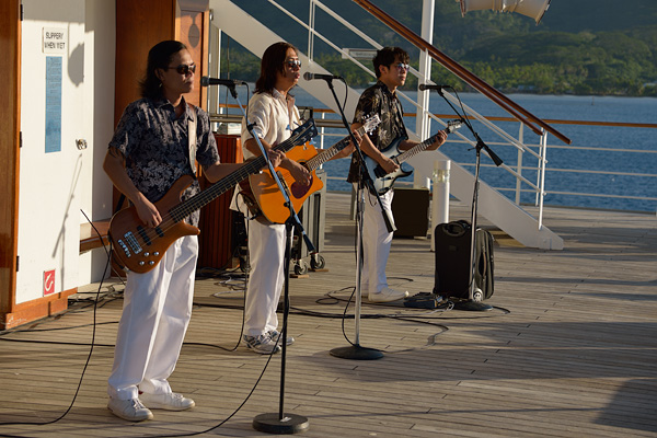 The band performing on the pool deck