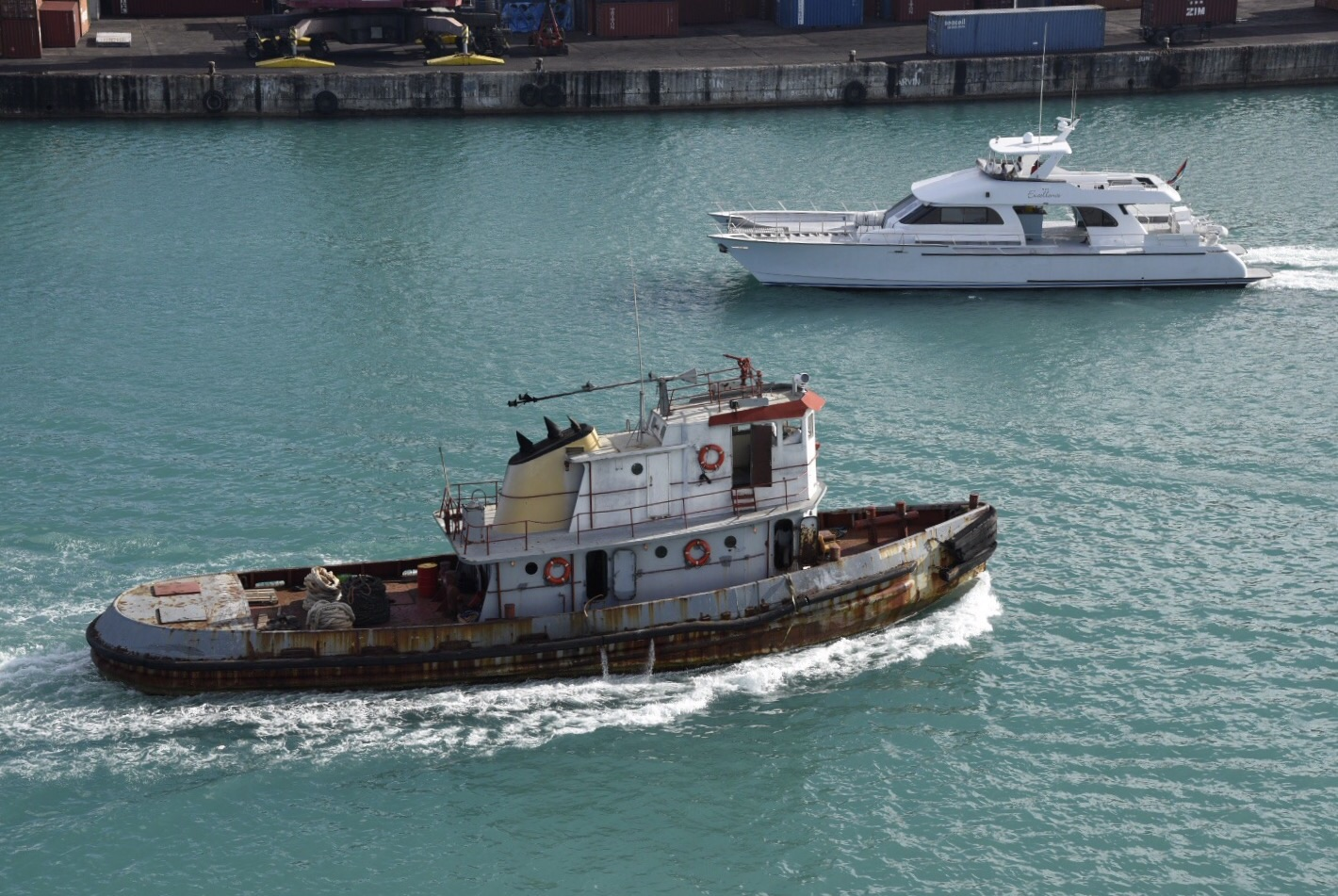 A tug and a motor yacht