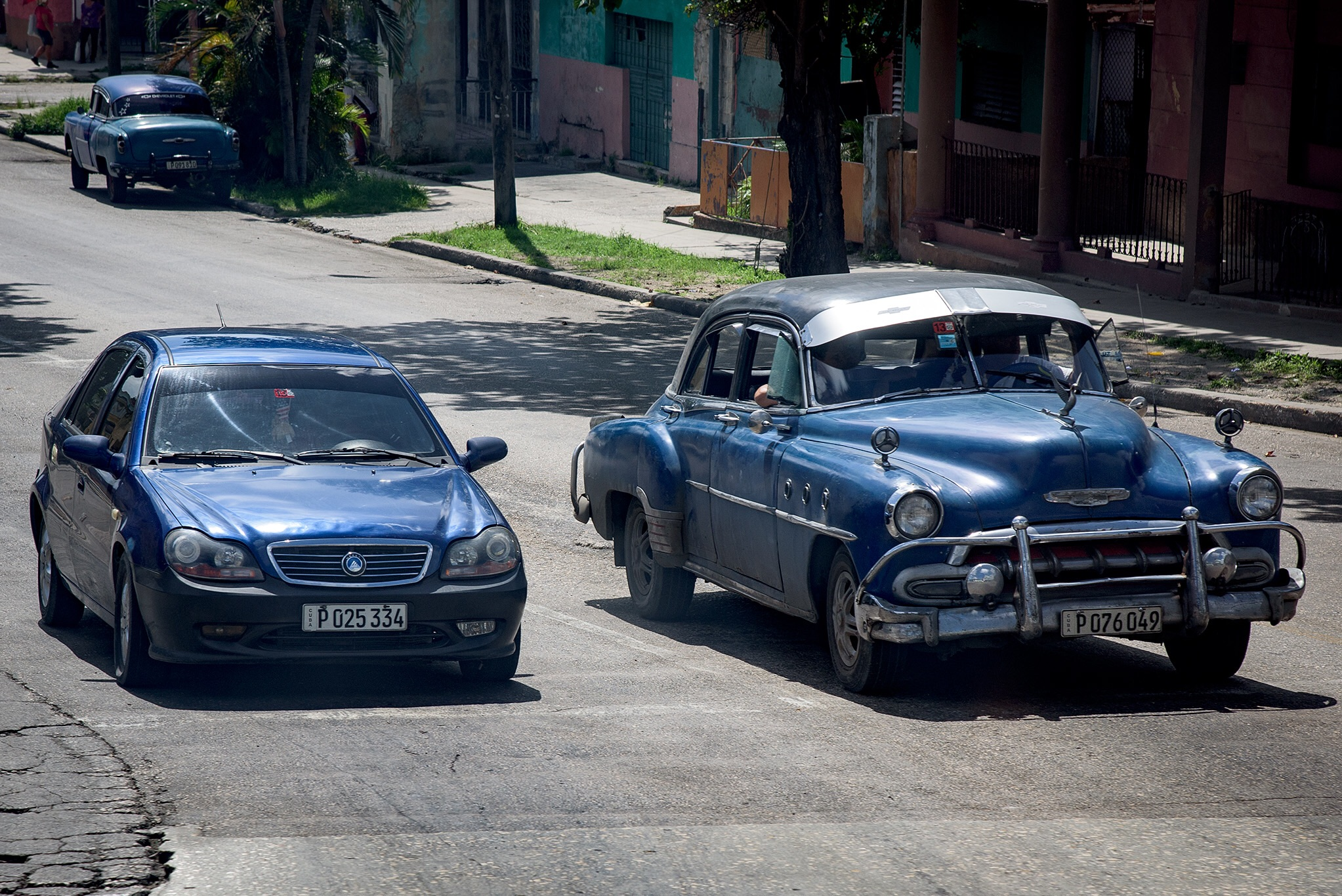 "A rare ""new"" car in Cuba alongside a private ""old"" car."