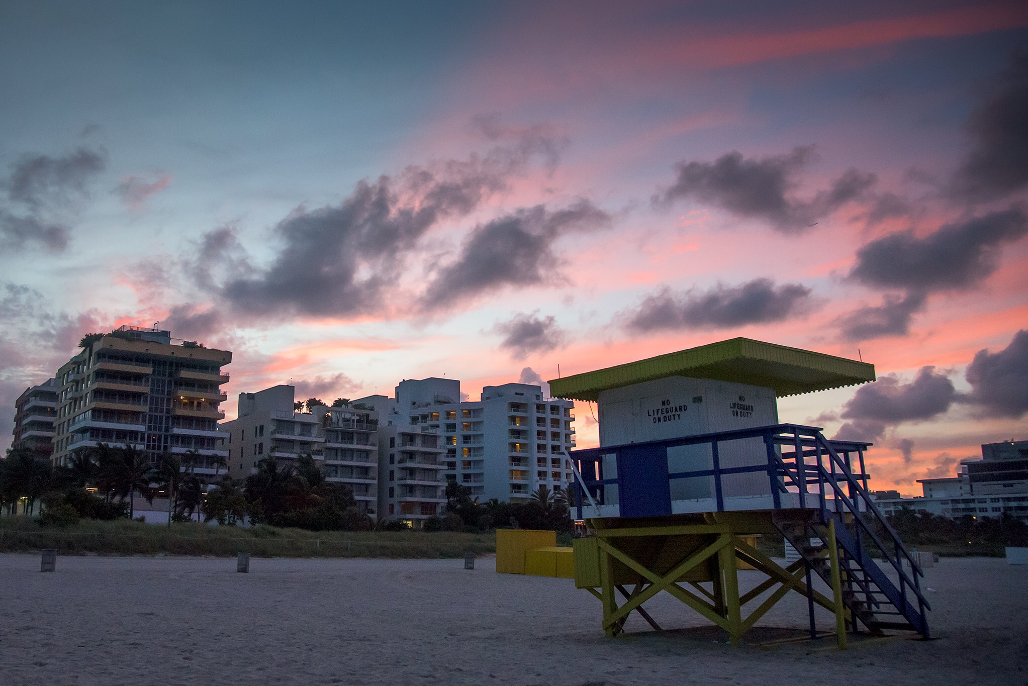 The sky puts on its own colorful display at sunset on South Beach