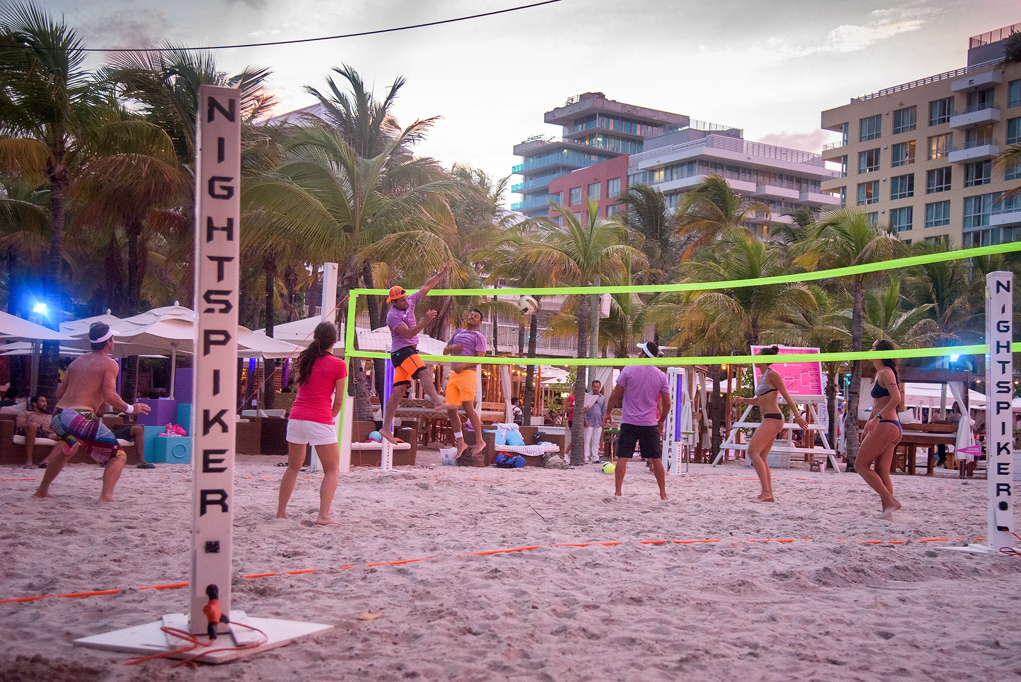 Sunday night beach volleyball at courts by South Beach amped up with lights and music and a bar!