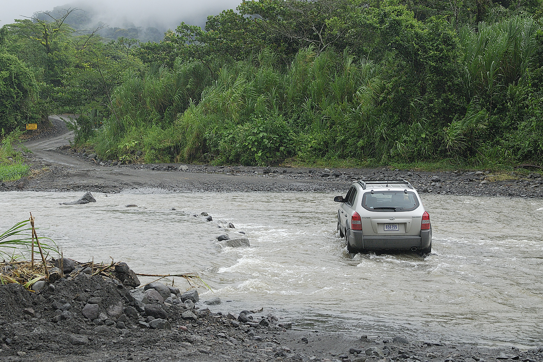 A local makes their way across a river, on my own in a rental car, I'm not sure I would have known exactly where to cross this river when we found the bridge was out!  Our group trip decided not to chance it, but they also had an alternate plan.