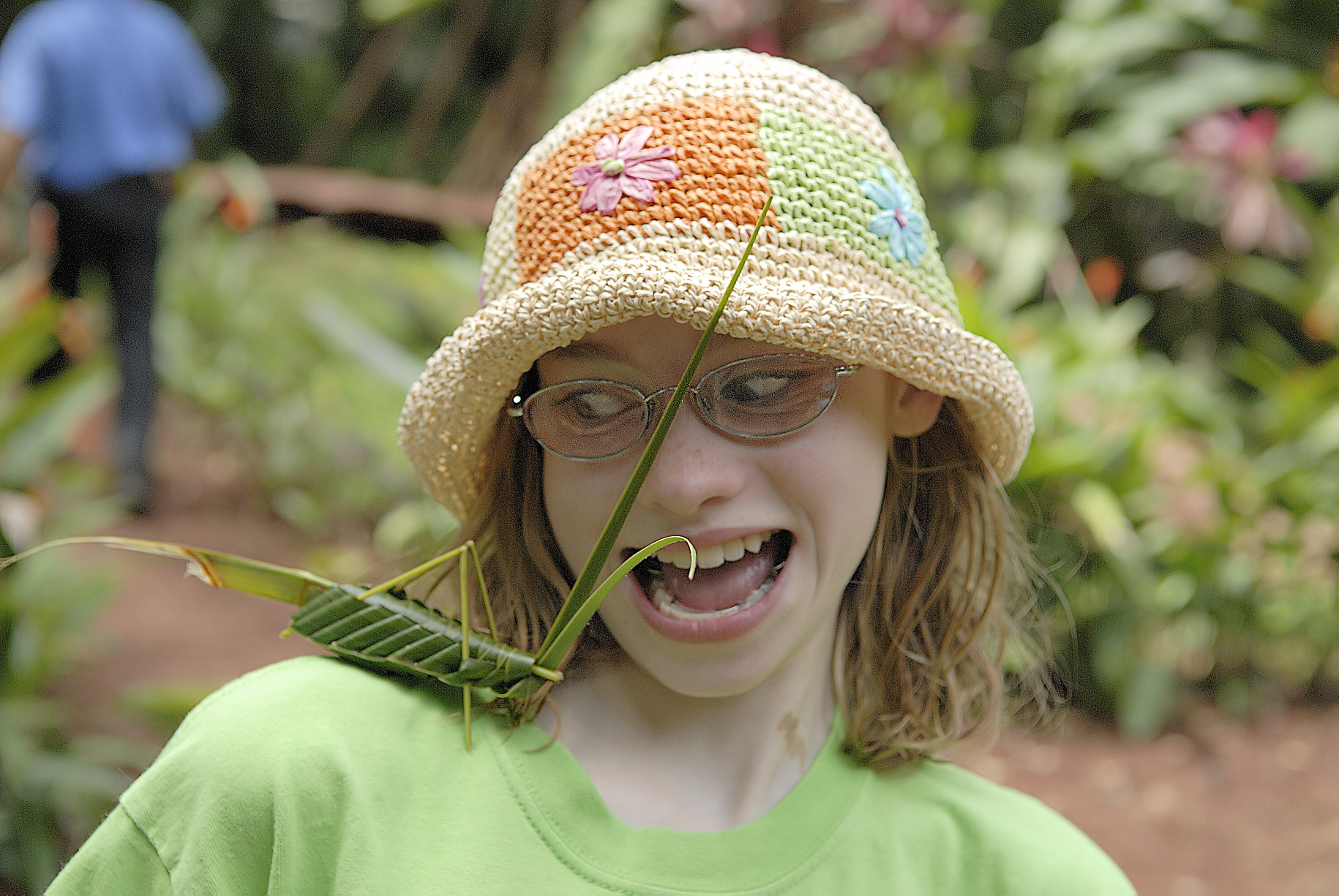 Our daughter is amateur actress and here she really sells her terror at this enormous grasshopper...made of grass by our guides in Costa Rica!