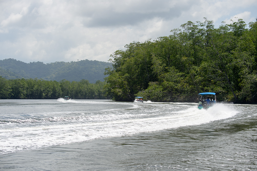 Boats make their way out of the Sierpe River to the Pacific to get to Drake Bay