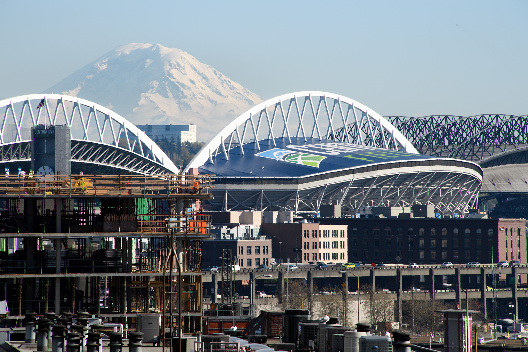 A view of Mt Ranier with the football and baseball stadiums in the foreground