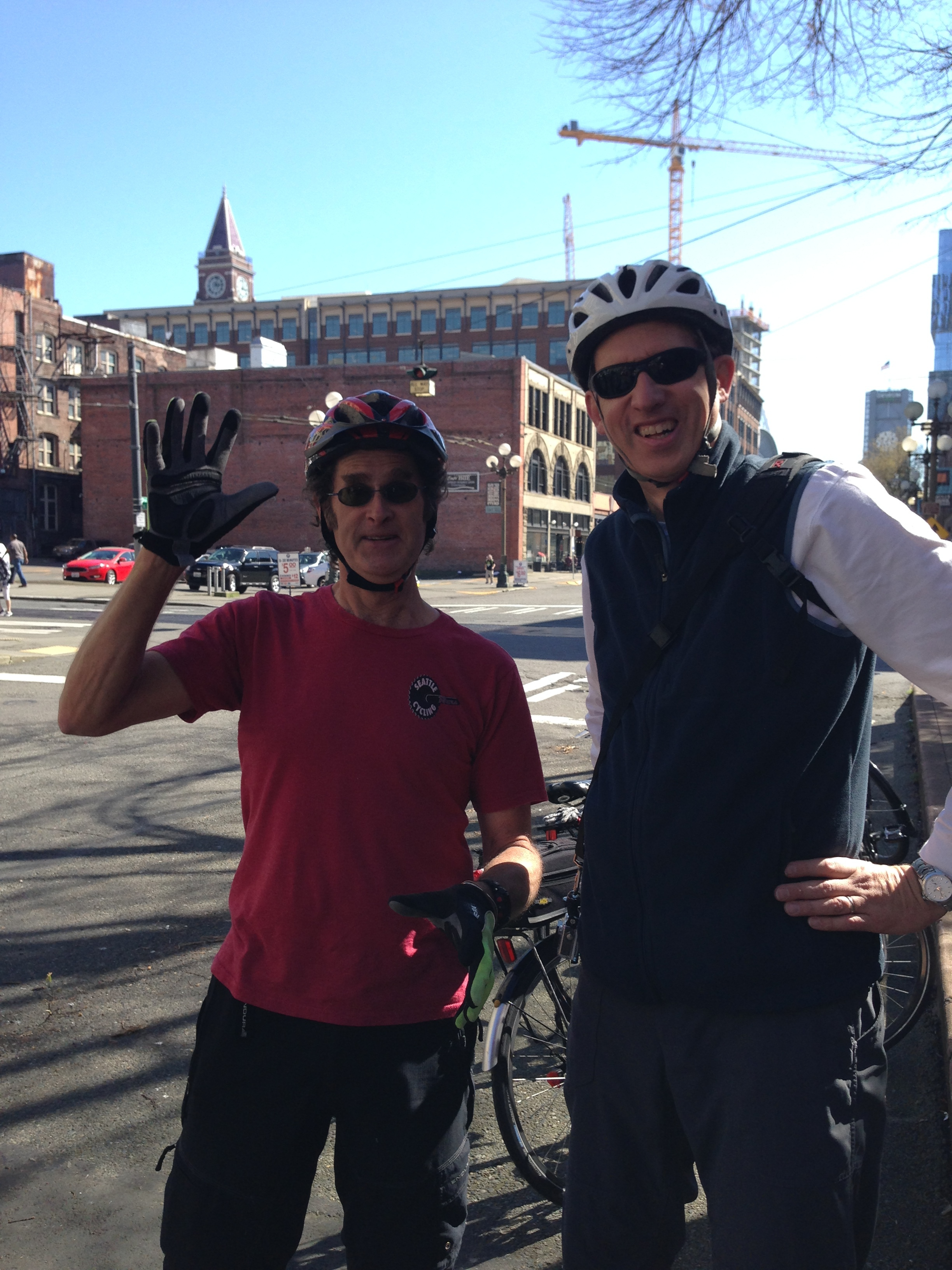 Craig of Seattle Cycling Tours with Super Jeff saving Seattle