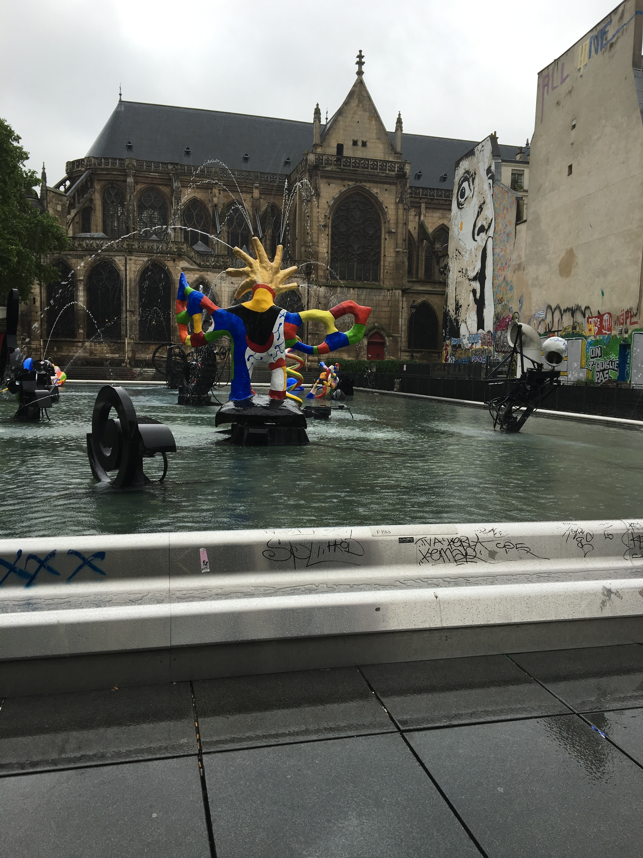 At Place de Igor Stavinsky, a contemporary fountain by Niki de St Phalle and Jean Tinguely sits in the shadow of the Gothic style St Merri 15th century church.