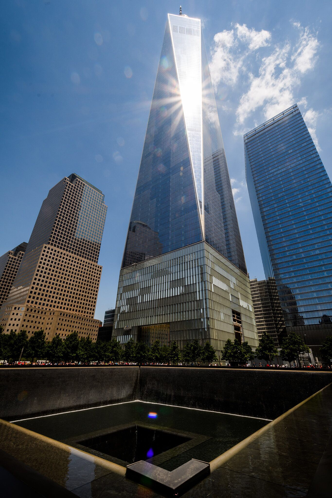 The dramatic 9/11 Memorial waterfall fills the foot prints of the original buildings.