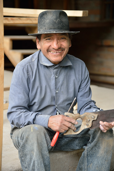 A gentleman at Peguche Falls poses while working with hand tools in Ecuador.The openness of people all over the world to allow us share their images and homelands has been heartwarming!