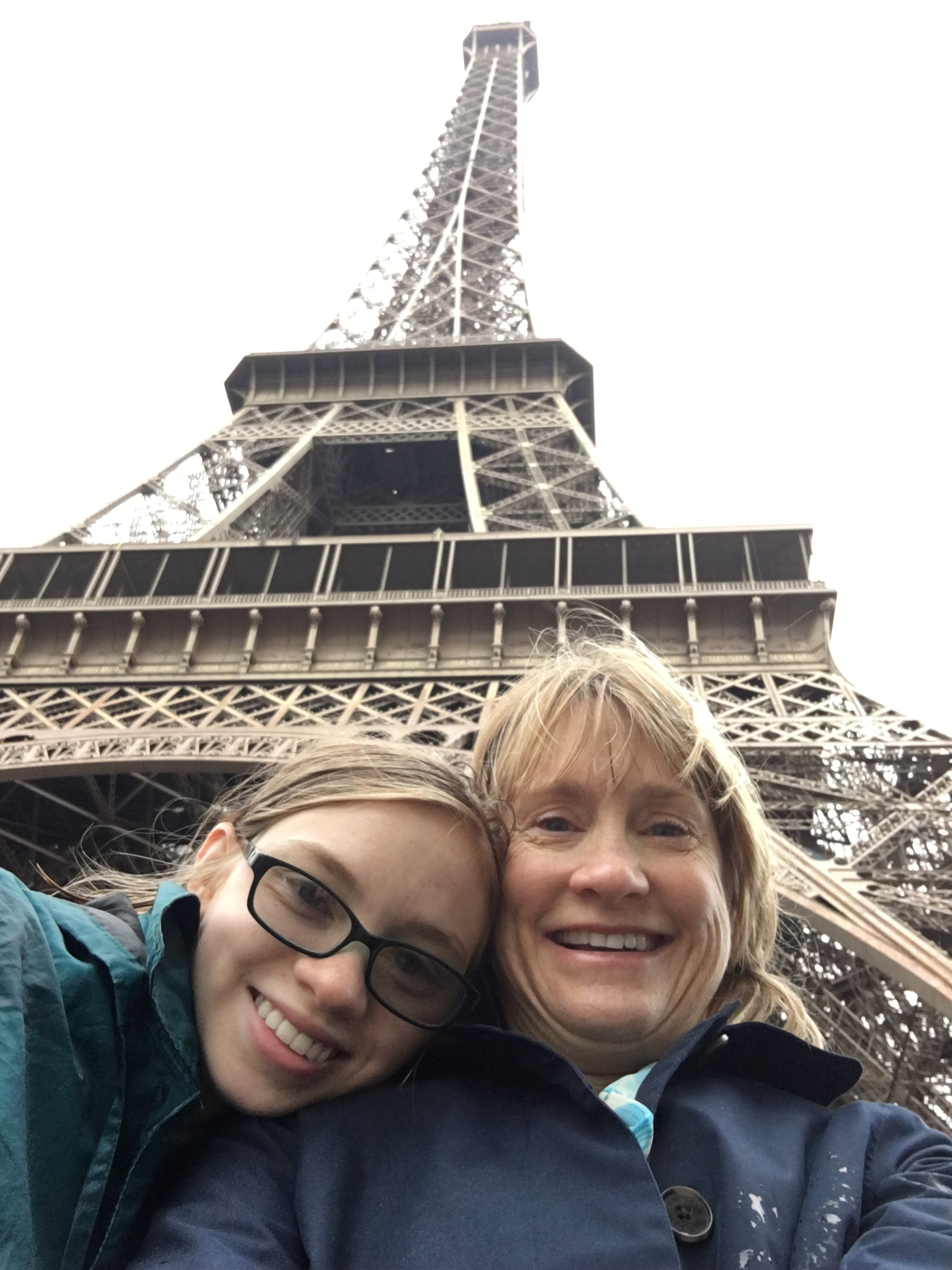 Early, rainy, and not quite high season! By following my tips for tourist destinations, we took an Eiffel selfie with no other photobombing tourists around!