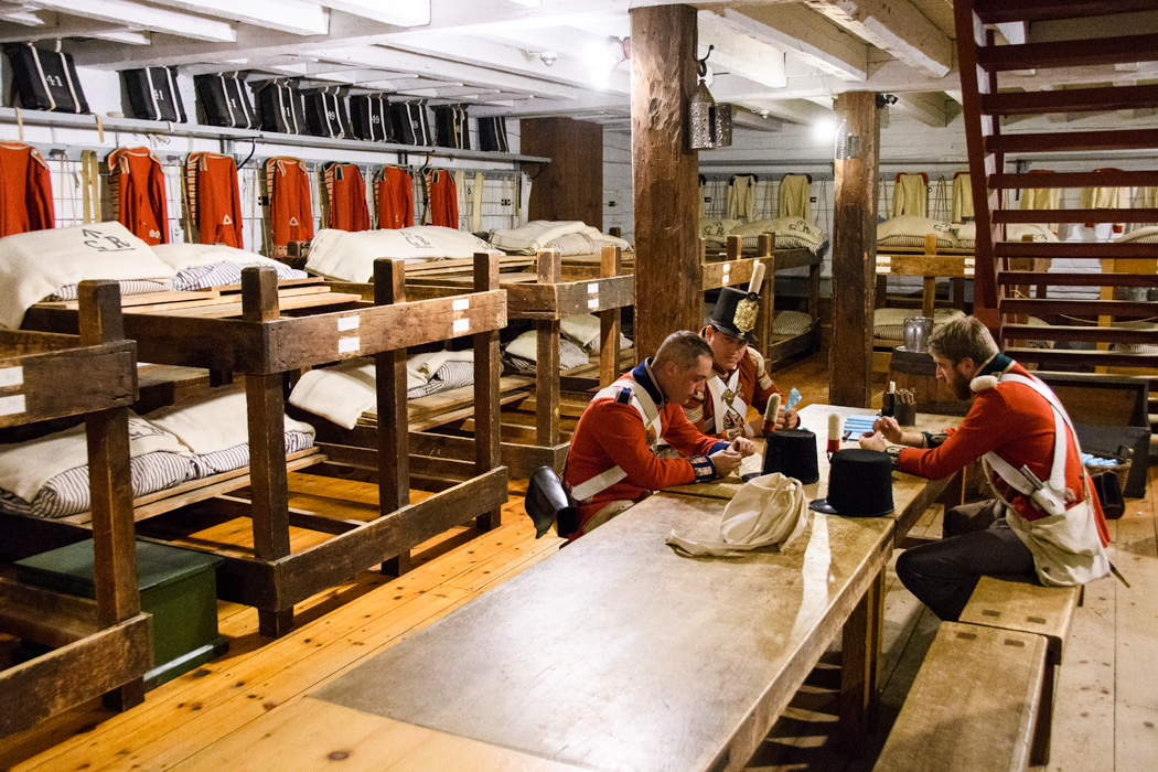 Re-enactors prepare powder for muskets in the barracks at Ft George at Niagara on the Lake.