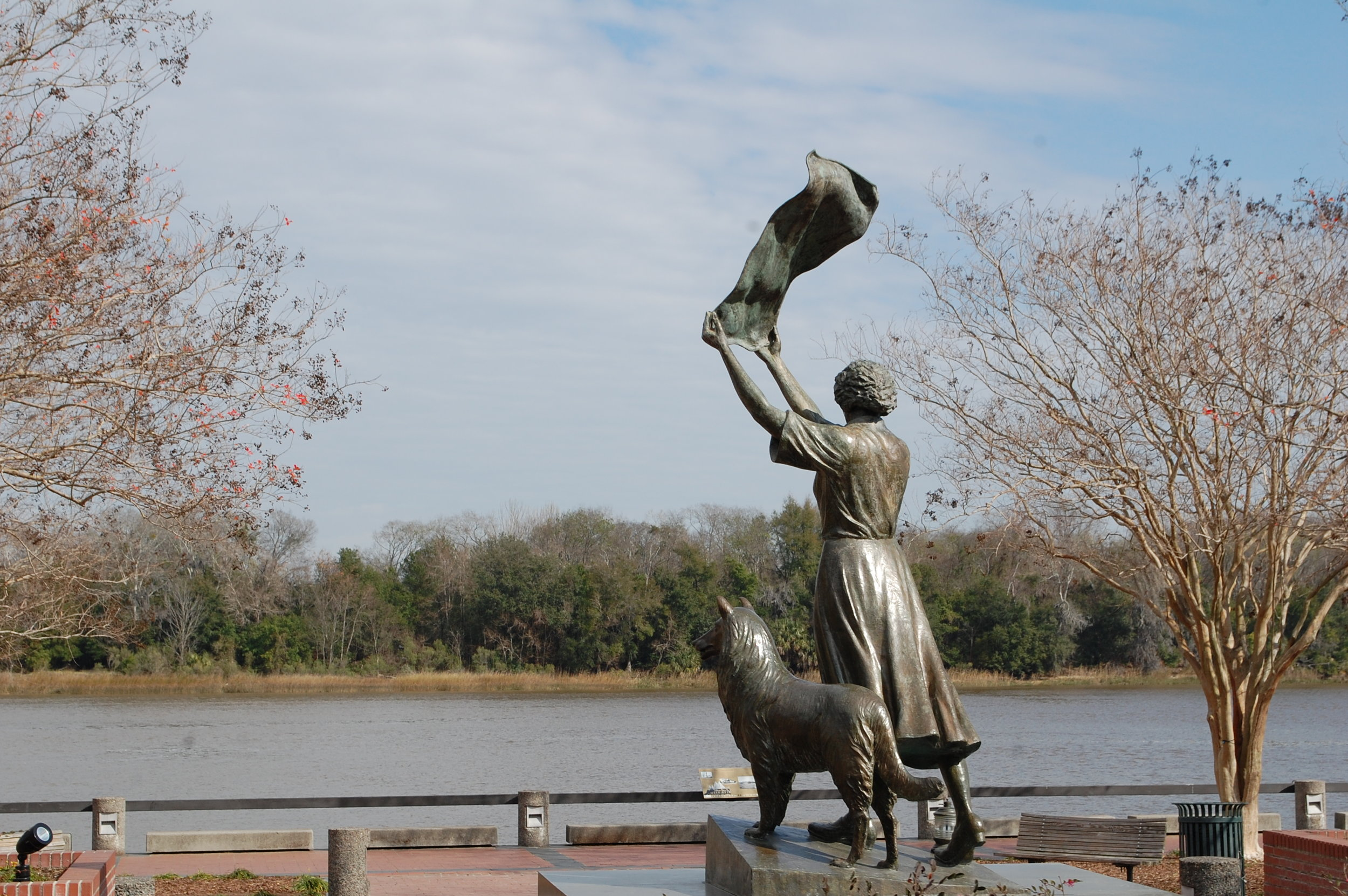 This statue is called the Waving Girl Statue on the River front. It depicts Florence Martus, whose family kept the island lighthouse, greeting sailors.