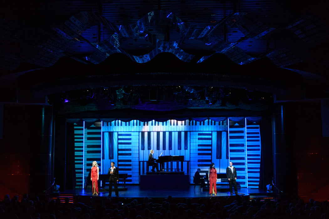 The production show featured a piano player and recorded music with live singers and dancers.