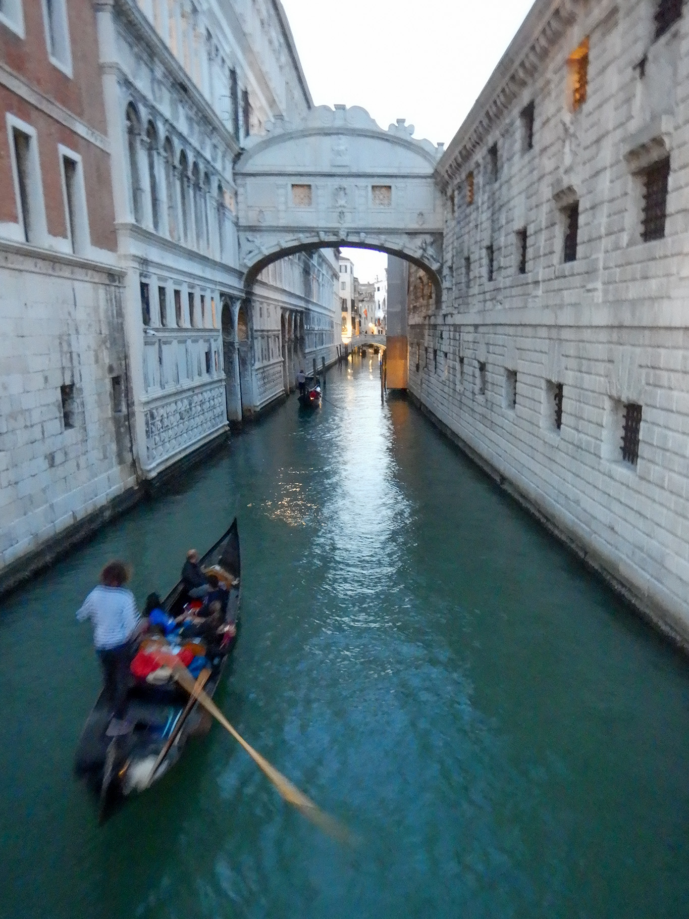 Dozens of gondolas full of tourists wend their way in the canals near St Marks Square.