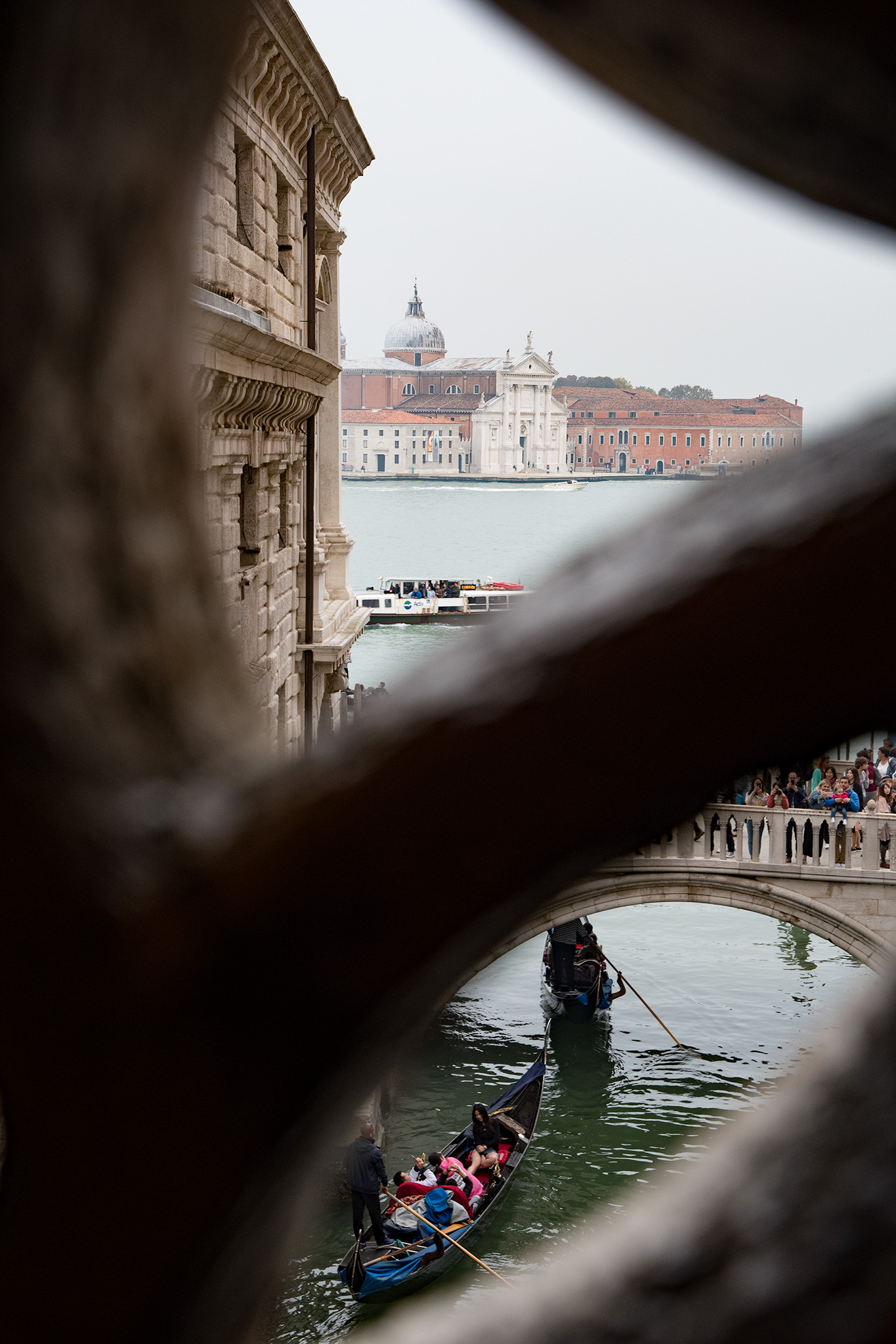 "The view prisoners would have had moving from the courts in Doges Palace to the prison along the ""Bridge of Sighs' Today, it's a view of dozens of tourists on Ponte della Paglia, jockeying for view of the Bridge of Sighs!"