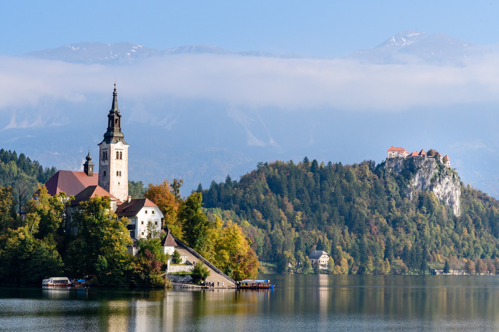 The Bled Castle looms in the distance, while equally scenic private villas line the shores of Lake Bled