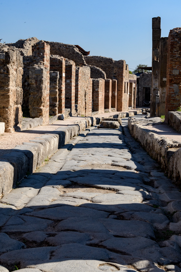 "A ""road"" in Pompeii...it's fun to see the ""ruts"" in the stone worn by the carts and carriages preserved since the first century AD."