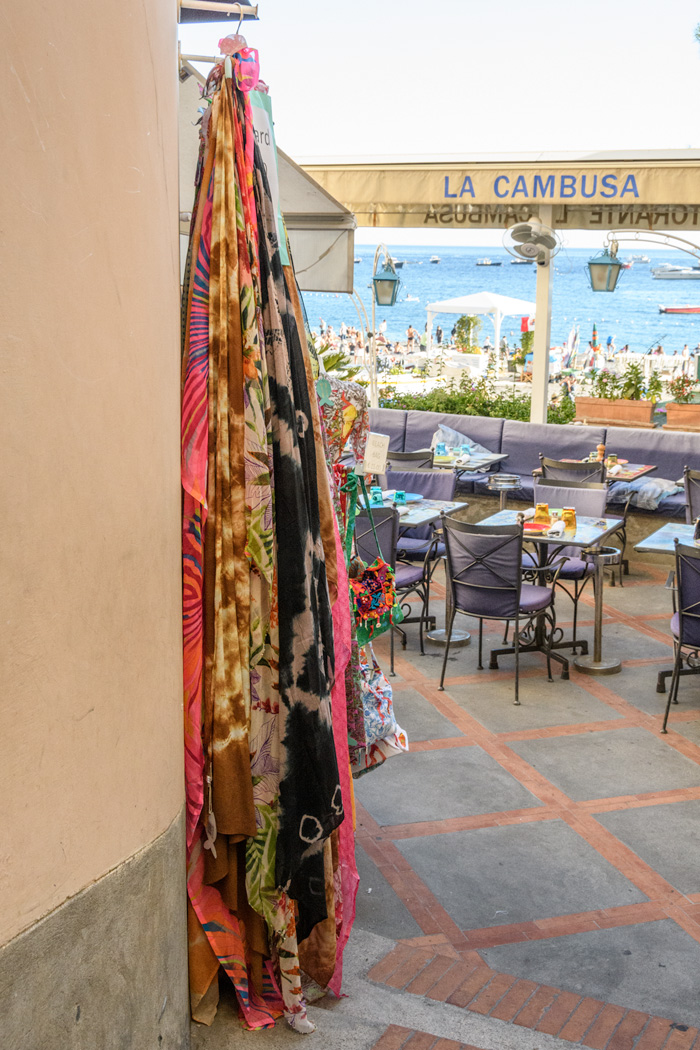 One of the best ways to enjoy Positano is to skip the crowds wending their way down the hill on the narrow roads and duck into one of the many cafes perched on the cliffs and enjoy the views while sipping Limoncello, a liqueur made from local lemons.
