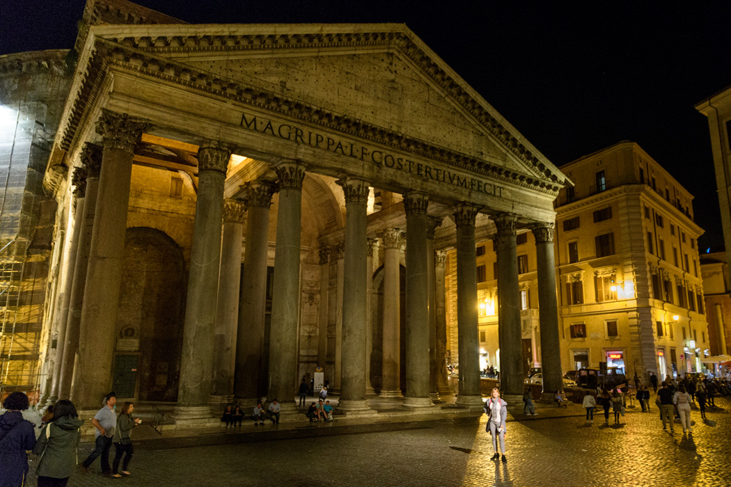 A building across from the Pantheon features a spotlight, that perfectly illuminates someone standing in front of the Pantheon, that's kathy in the spotlight!