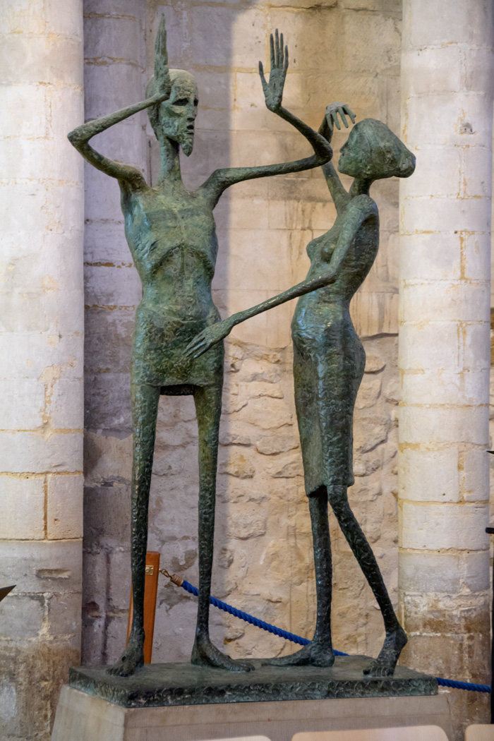 A modern sculpture of Jesus and Mary Magdalene