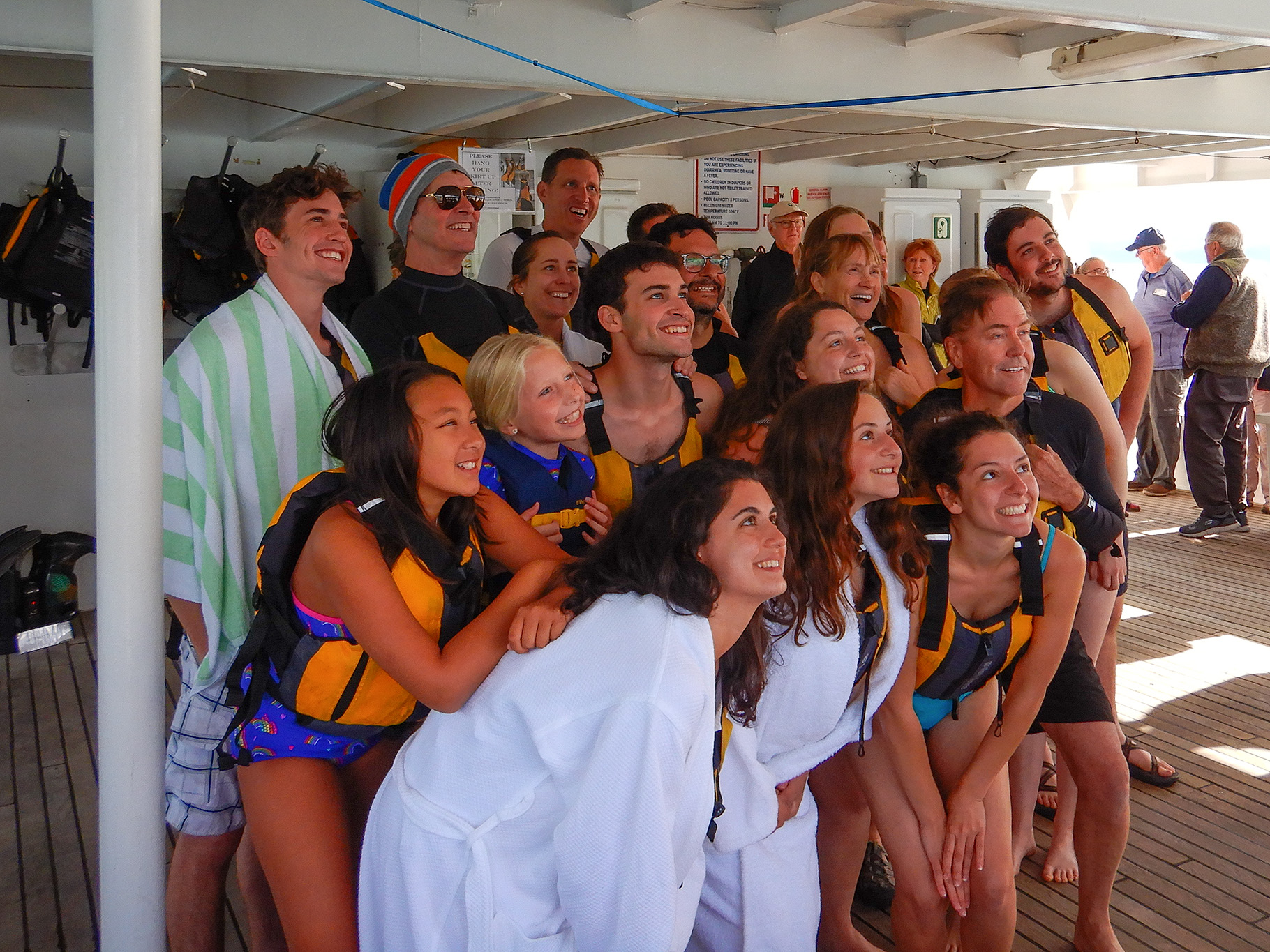 """Brave passengers gather before going for a """"polar plunge"""" in Southeast Alaska"""