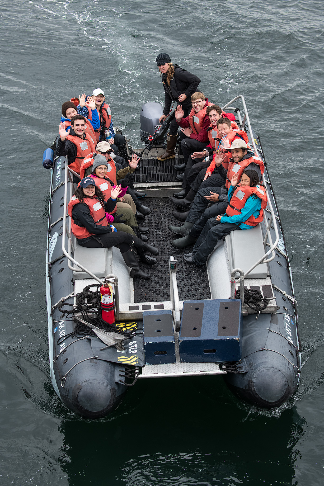 A group goes out on excursion in one of the skiff boats, with Alex at the helm