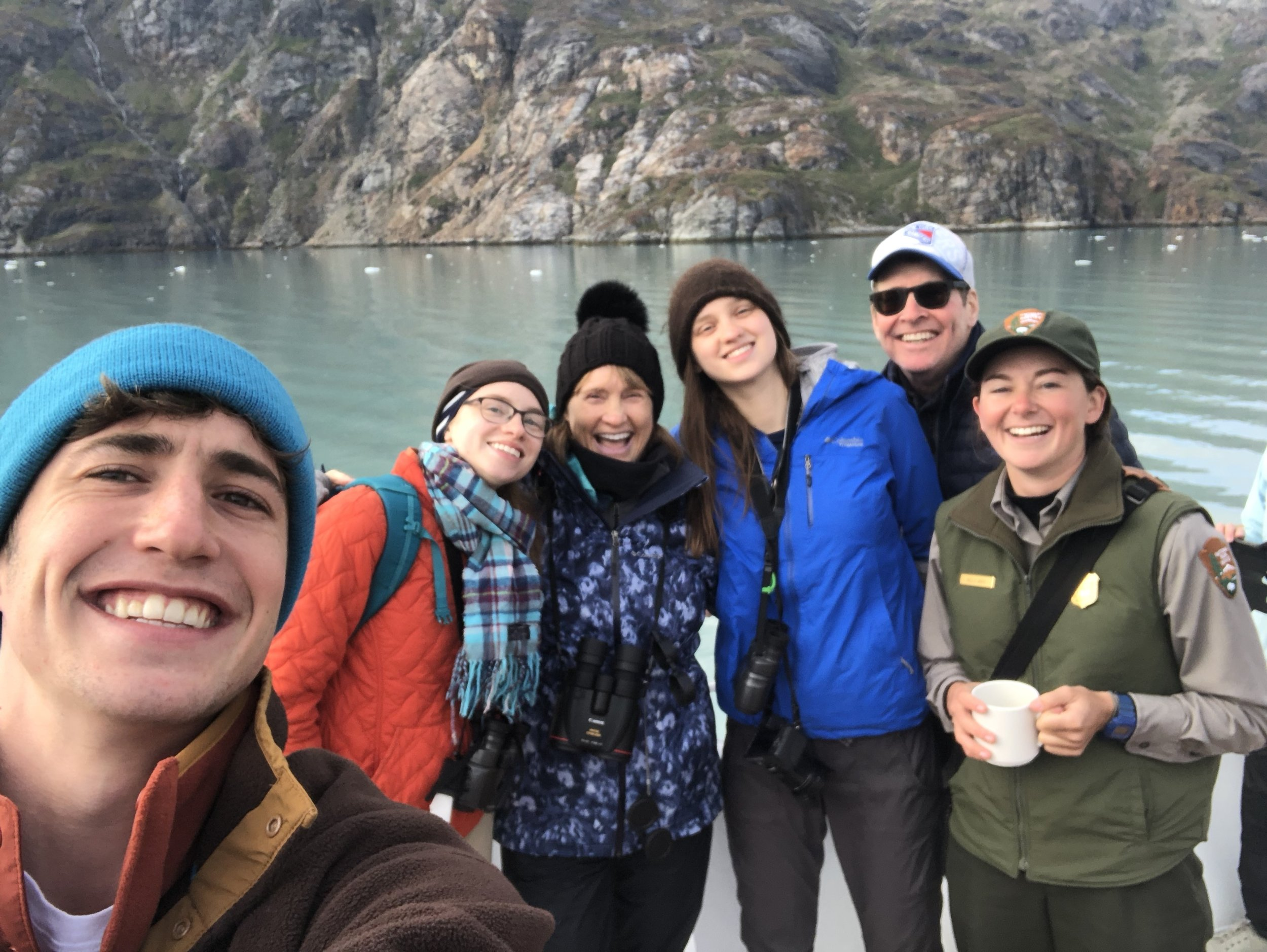 Ranger Kelly takes a minute from spotting wildlife and explaining the geology of Glacier Bay National Park to pose for a selfie with passengers if the Safari Endeavor.