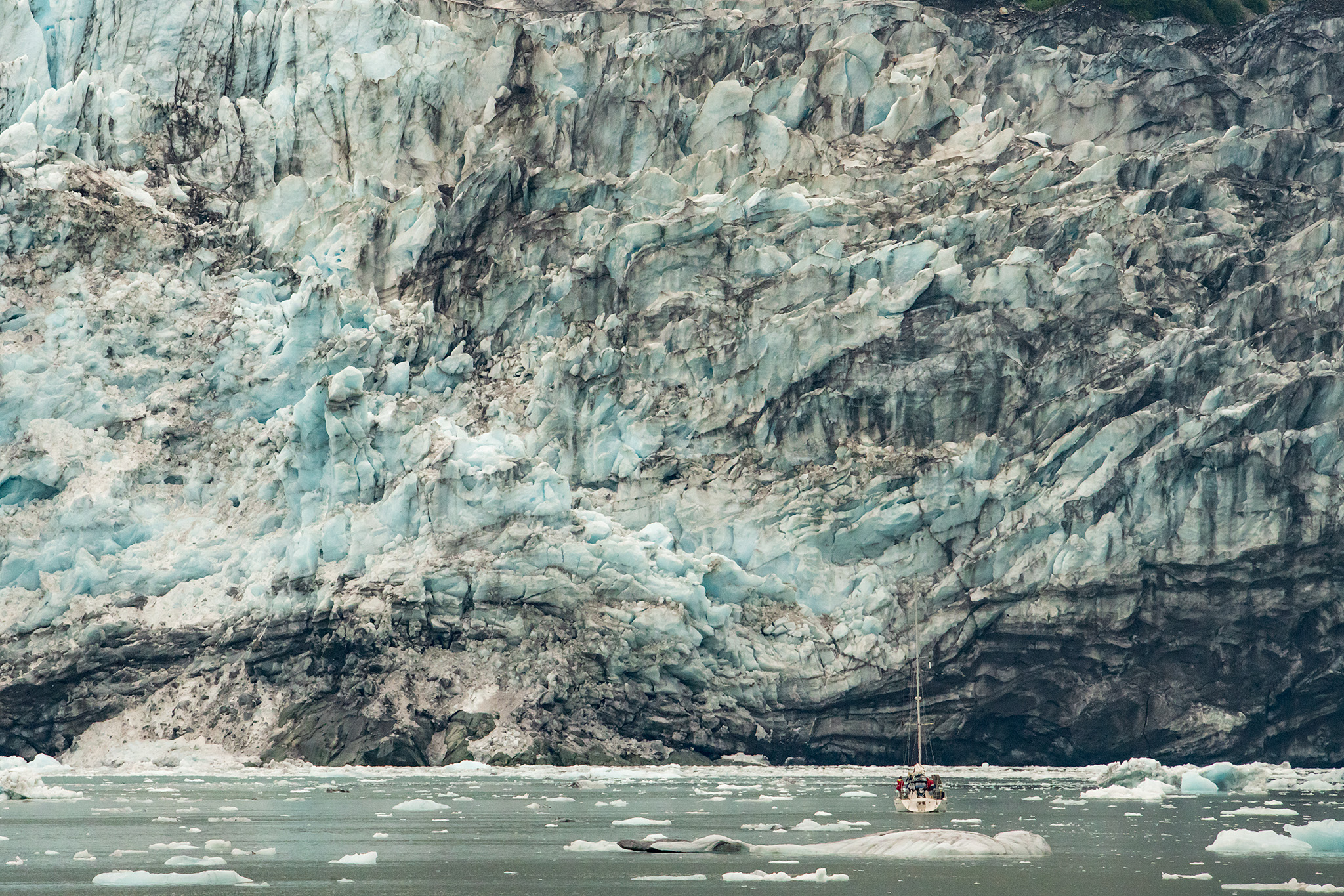 Can you spot the sailboat? This 25-40 foot sailboat is dwarfed by the glacier!