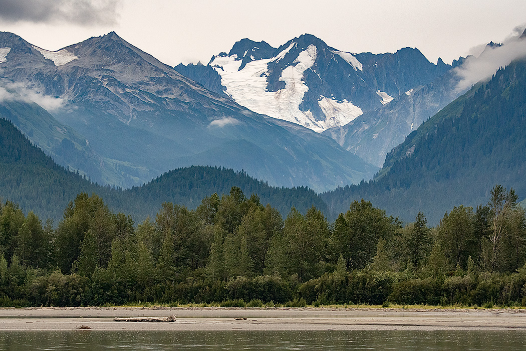 A drive along the Chilkat Pass, despite ongoing construction, allows alluring views of mountains, eluvial river, and glaciers that define Southeast Alaska.