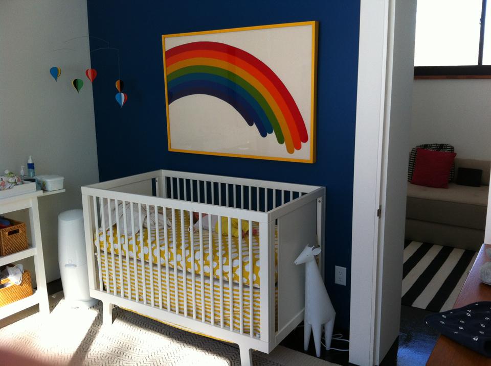Happy rainbow print on fabric framed in yellow.