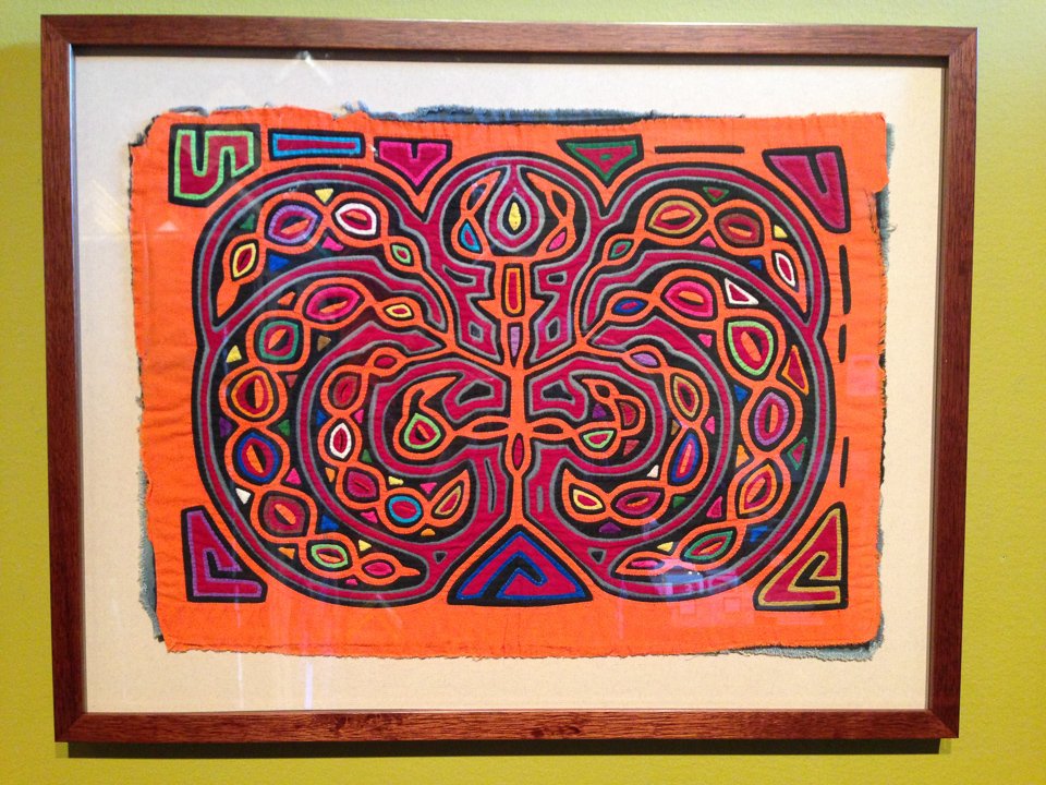 Hmong tapestry float mounted and shadowboxed in cherry frame