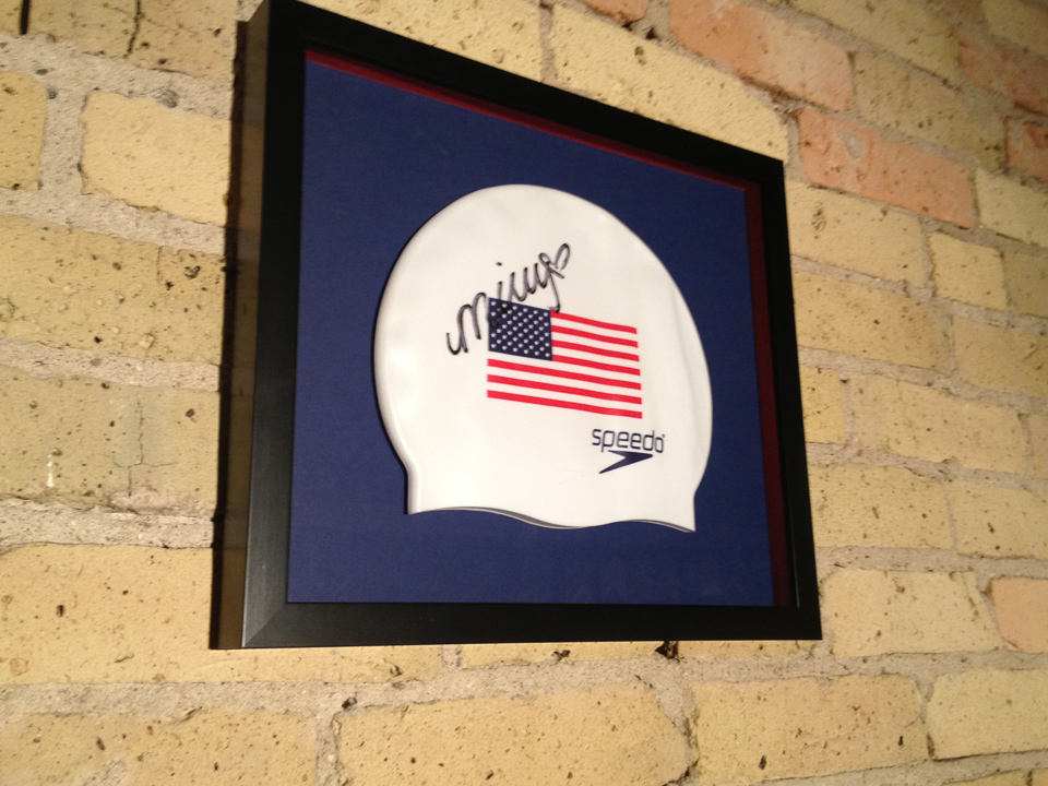 Team USA  swim cap shadowboxed in black with red glass spacers.
