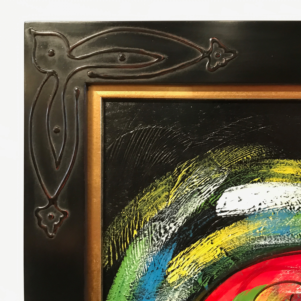 Detail of black over red clay frame with corner detail and gold insert.