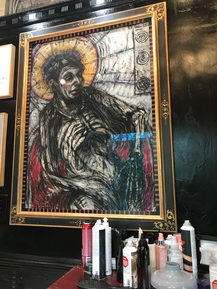 Matt Franzen drawing framed in ornate sgraffito frame with striped liner.