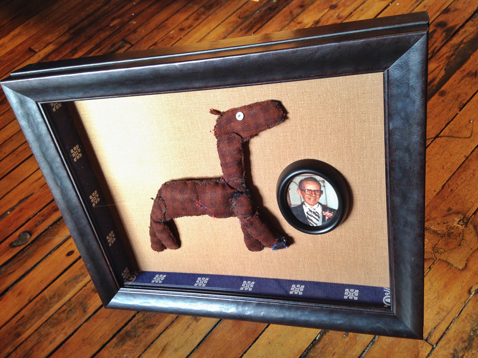 Ode to Grandfather - a toy he made and the bandanna it was wrapped in - shadowboxed in a faux leather frame.