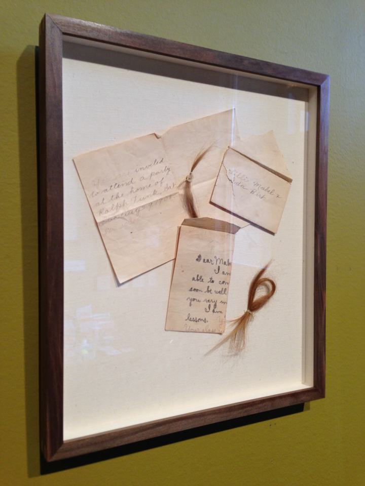A collection of keepsakes floated on linen and framed in walnut