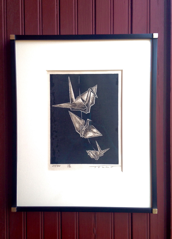 Japanese origami print framed in black with white gold Hick's corners.
